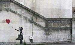 Картина Бэнкси самоуничтожилась. Сразу после продажи за миллион фунтов на аукционе Sotheby's